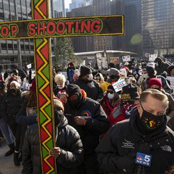 The Rev. Michael Pfleger led a silent, anti-violence march Thursday along North Michigan Avenue.