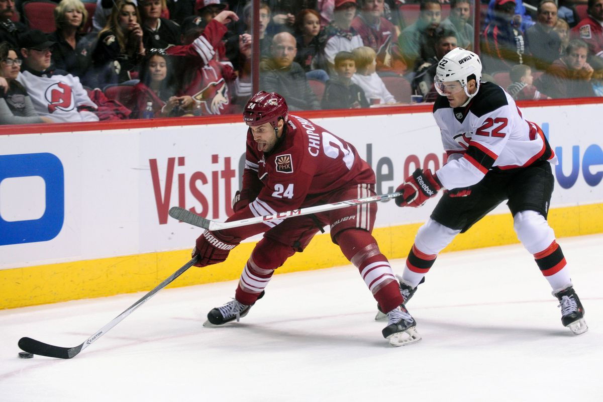 A common sight in January: Eric Gelinas behind the puck carrier.