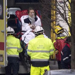 A woman is evacuated in an ambulance by emergency services after a explosion in a main metro station in Brussels on Tuesday, March 22, 2016. Explosions rocked the Brussels airport and the subway system Tuesday, killing at least 13 people and injuring many others just days after the main suspect in the November Paris attacks was arrested in the city, police said.