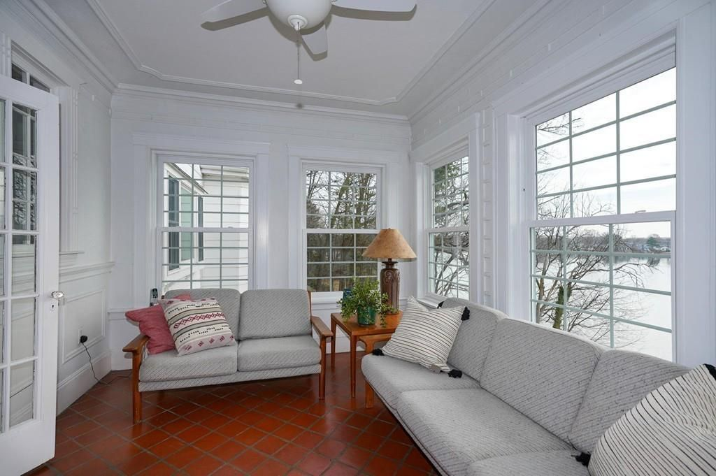 A sunroom with furniture.
