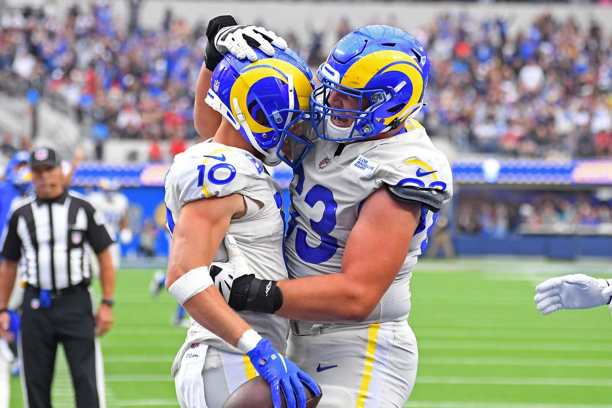 Los Angeles Rams wide receiver Cooper Kupp (10) is congratulated by offensive guard Austin Corbett (63) after scoring a touchdown in the second half of the game against the Tampa Bay Buccaneers at SoFi Stadium.