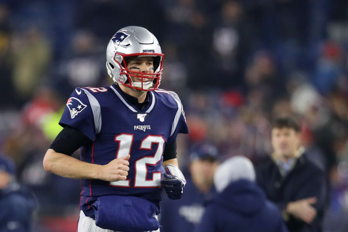 Tom Brady of the New England Patriots runs onto the field before the AFC Wild Card Playoff game against the Tennessee Titans at Gillette Stadium on January 04, 2020 in Foxborough, Massachusetts.