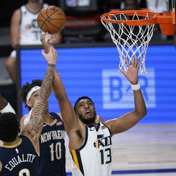 Utah Jazz's Tony Bradley (13) reaches for a rebound along with New Orleans Pelicans' Jaxson Hayes (10) and Lonzo Ball as Pelicans' Jrue Holiday (11) watches in the background during the second half of an NBA basketball game Thursday, July 30, 2020, in Lake Buena Vista, Fla. (AP Photo/Ashley Landis, Pool)