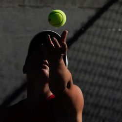 Erika Olsen, of Bear River, serves the ball to Bailey Huebner, of Green Canyon, during the final singles match of the 4A girls tennis state tournament at Liberty Park Tennis Center in Salt Lake City on Saturday, Oct. 2, 2021.