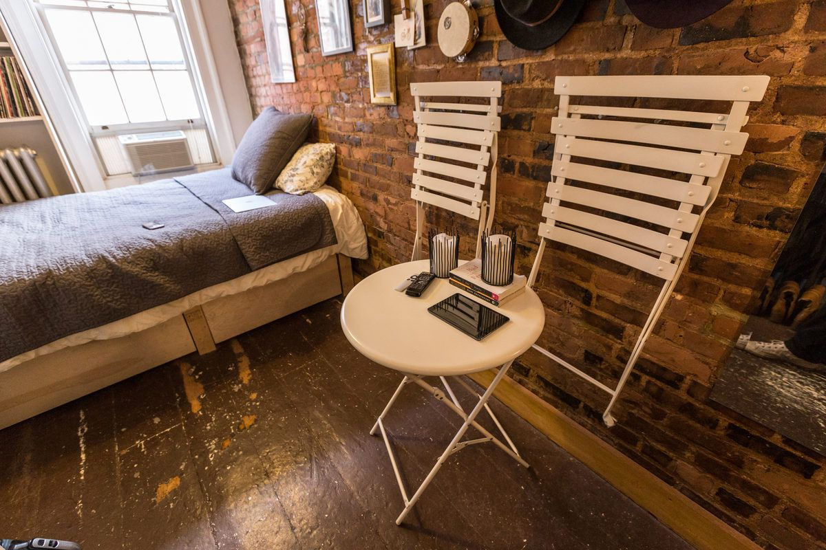 """The seating panic subsided when her friend suggested a bistro set that could hang on the wall when not in use. """"I really enjoy knowing that the chairs can be put away when they are down."""""""