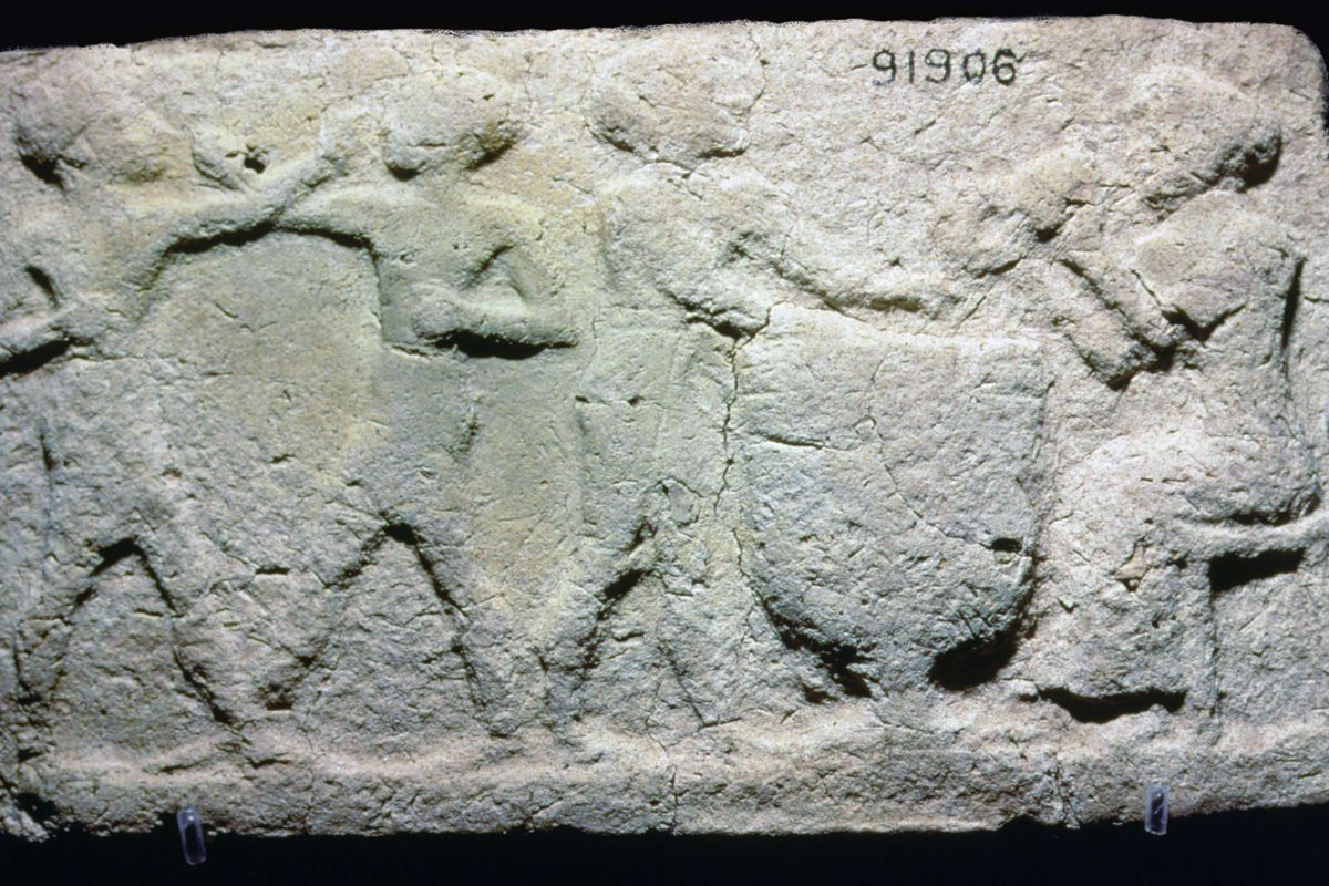 A plaque from ancient Mesopotamia showing two boxers fighting