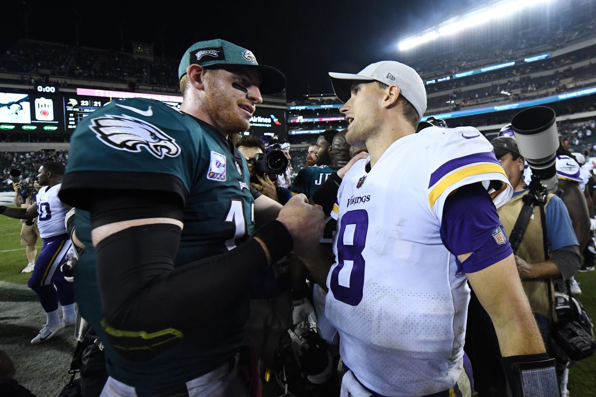 Philadelphia Eagles quarterback Carson Wentz shakes hands with Minnesota Vikings quarterback Kirk Cousins after the game at Lincoln Financial Field.