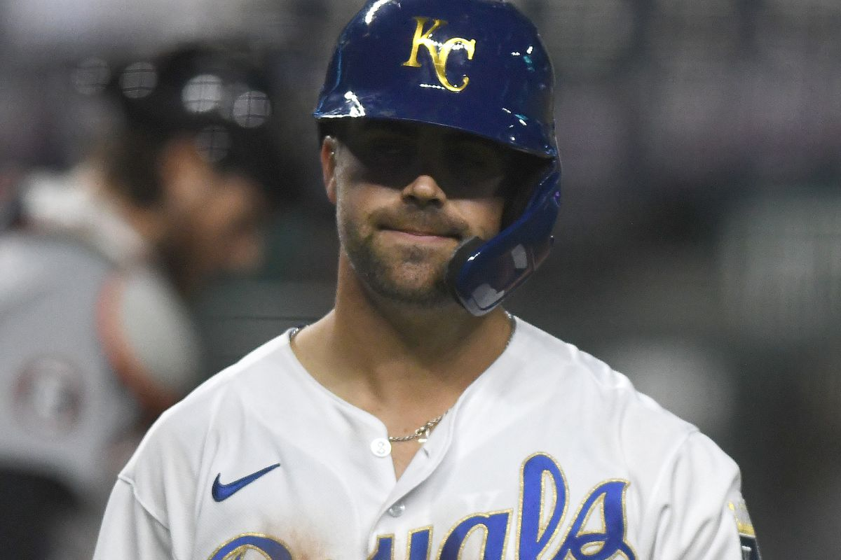 Whit Merrifield reacts after striking out in a 2020 baseball game.