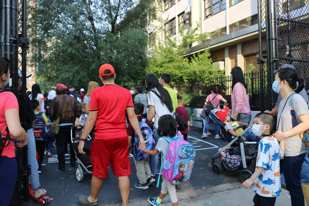 A crowd of students and parents arrive at P.S. 184 on the first day of school.