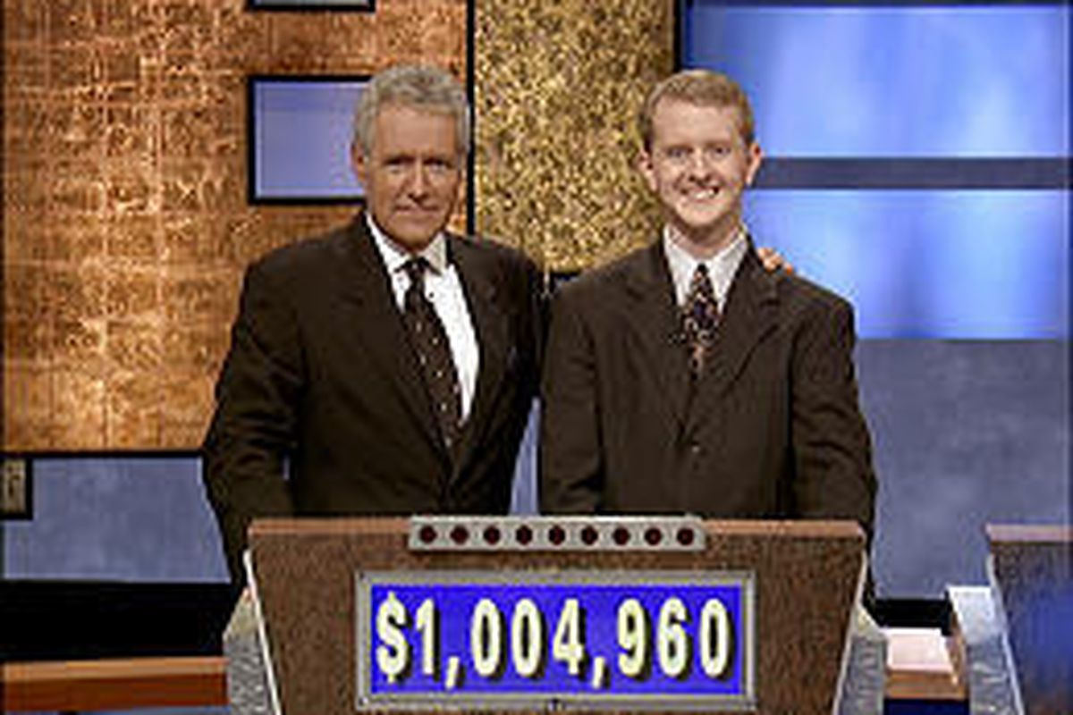 Host Alex Trebek poses with Ken Jennings after the Murray resident's 30th consecutive win on Tuesday.