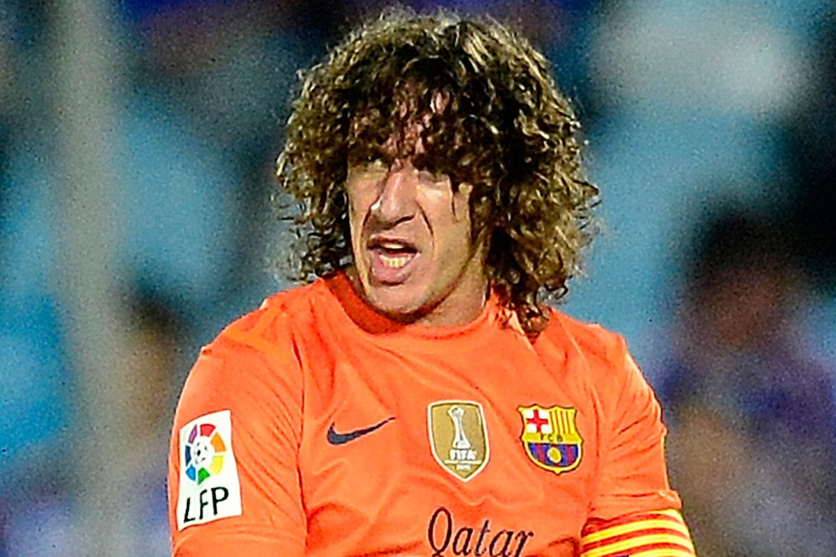 Carles Puyol injury Barcelona defender hurts arm against Benfica