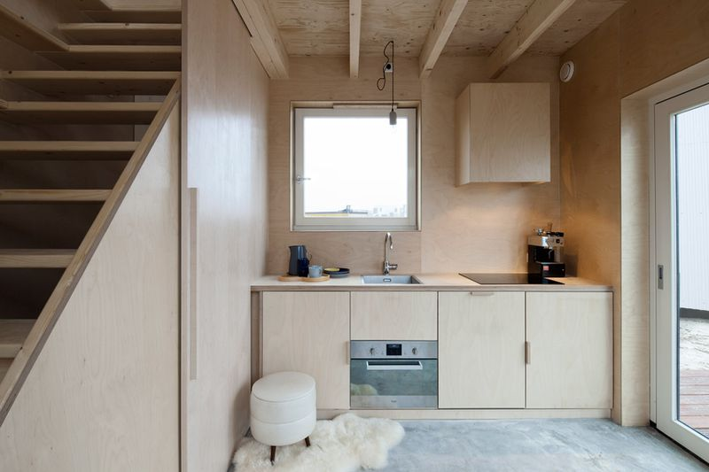 micro home. The latest addition to the trend is Slim Fit  a slat covered timber home in Almere Poort Netherlands from Ana Rocha Architecture Skinny micro spreads space saving tricks over three stories