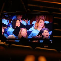 A recording of a Tabernacle Choir at Temple Square performance is shown in the Conference Center Theater during the Sunday morning session of the 190th Semiannual General Conference of The Church of Jesus Christ of Latter-day Saints on Oct. 4, 2020.