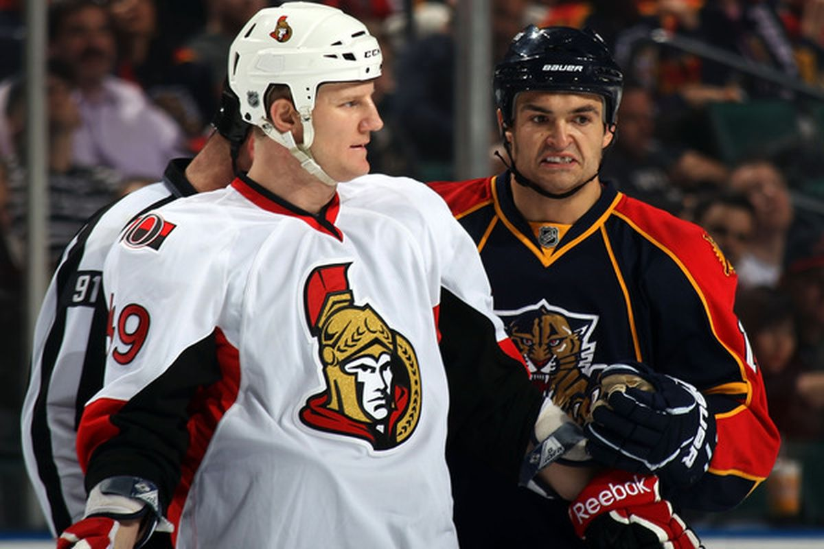 SUNRISE, FL - MARCH 10: Francis Lessard #49 of the Ottawa Senators and Darcy Hordichuk #16 of the Florida Panthers exchange words at the BankAtlantic Center on March 10, 2011 in Sunrise, Florida.  (Photo by Bruce Bennett/Getty Images)