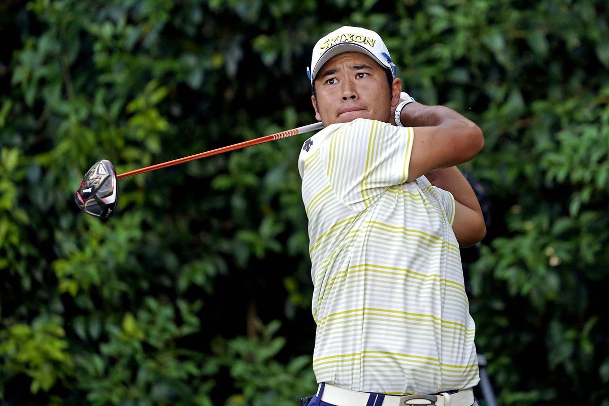 Hideki Matsuyama plays his shot from the 14th teeduring the final round of The Masters golf tournament.