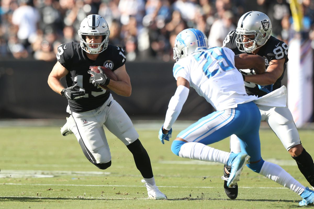 Oakland Raiders wide receiver Hunter Renfrow runs with the ball after making a catch against the Detroit Lions in the second quarter at Oakland Coliseum.