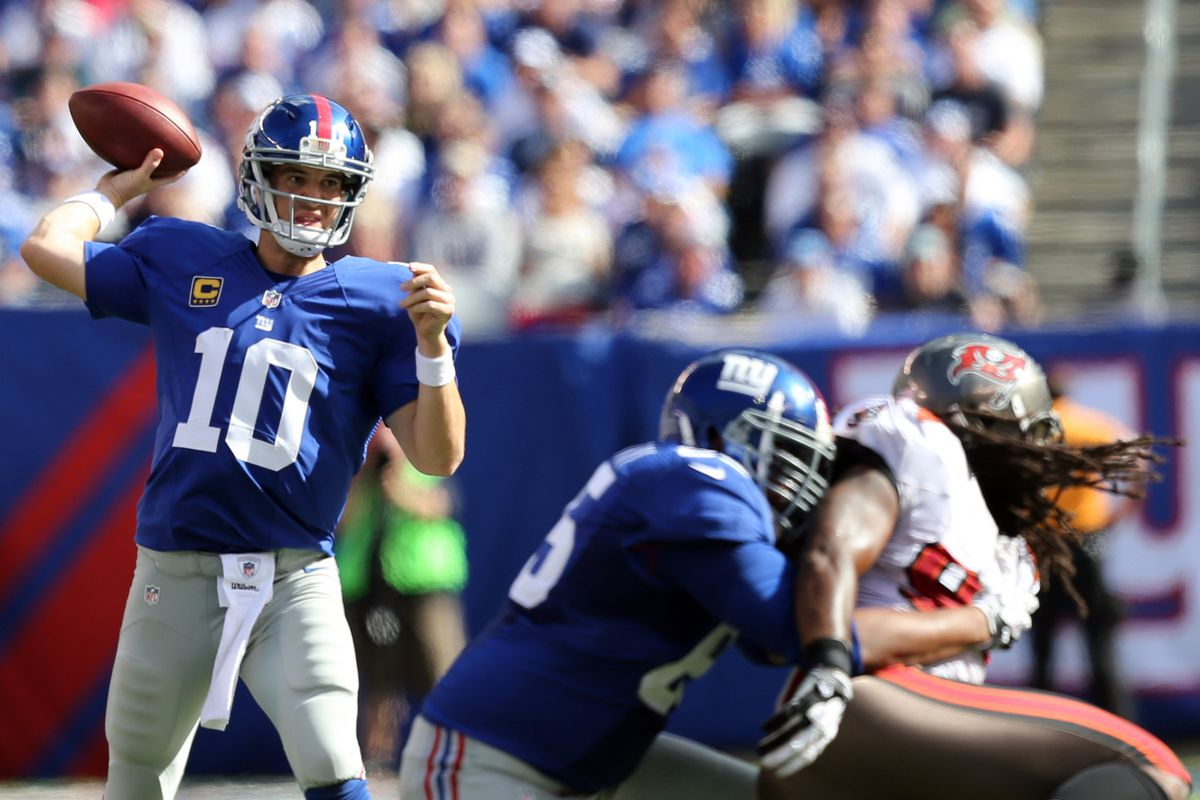 Sep 16, 2012; East Rutherford, NJ,  New York Giants quarterback Eli Manning (10) throws a pass during the fourth quarter against the Tampa Bay Buccaneers at MetLife Stadium. Giants won 41-34.  Mandatory Credit: Anthony Gruppuso-US PRESSWIRE