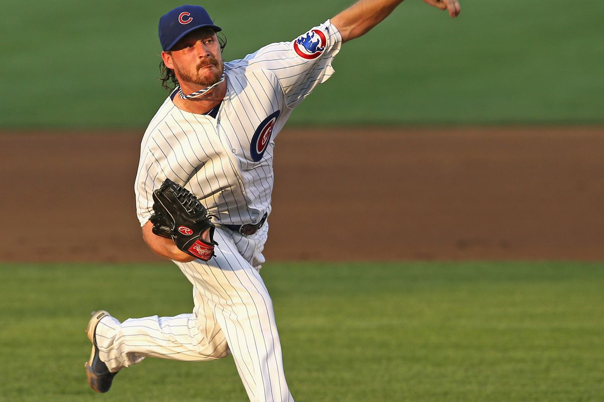 Starting pitcher Travis Wood of the Chicago Cubs delivers the ball against the Miami Marlins at Wrigley Field in Chicago, Illinois.  (Photo by Jonathan Daniel/Getty Images)