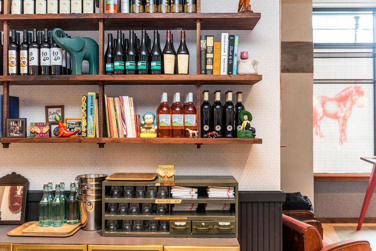 Kitschy animal trinkets surround wine bottles at ABC Pony