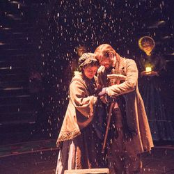 """Mr. and Mrs. Bob Cratchit hold Tiny Tim's crutch in Hale Centre Theatre's 2016 production of """"A Christmas Carol."""""""