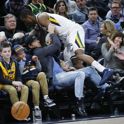 Utah Jazz guard Alec Burks (10) slams into fans in Salt Lake City on Thursday, Dec. 21, 2017. Utah won 100-89.