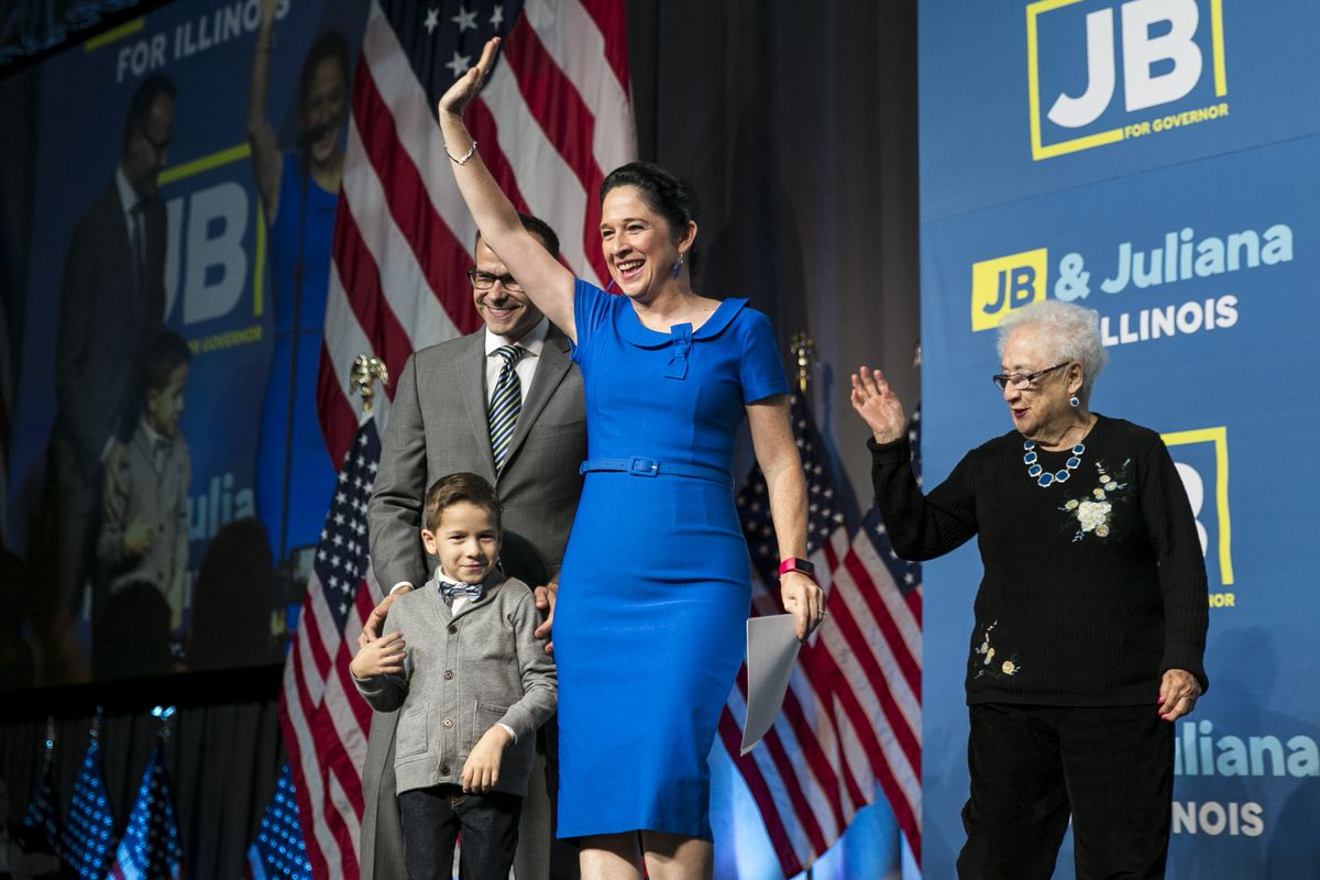 State Comptroller Susana Mendoza celebrates with her husband, David, and their then 5-year-old son David at an election night rally in 2018. Mendoza's mother, Susana H. Mendoza, then 83, waves behind them.