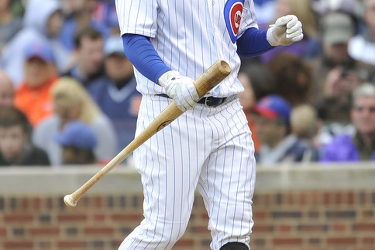 Darwin Barney of the Chicago Cubs walks back to the dugout after striking out against the Los Angeles Dodgers at Wrigley Field in Chicago, Illinois.  (Photo by Brian Kersey/Getty Images)