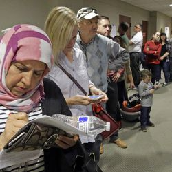 Hana Alshamry, left, waits in line with others to vote at the Holladay City Hall on Nov. 8, 2016, in Holladay, Utah. Utah\'s mostly Mormon, mostly Republican voters went to the polls to determine if the GOP\'s five-decade winning streak in presidential elections would remain intact or be snapped.