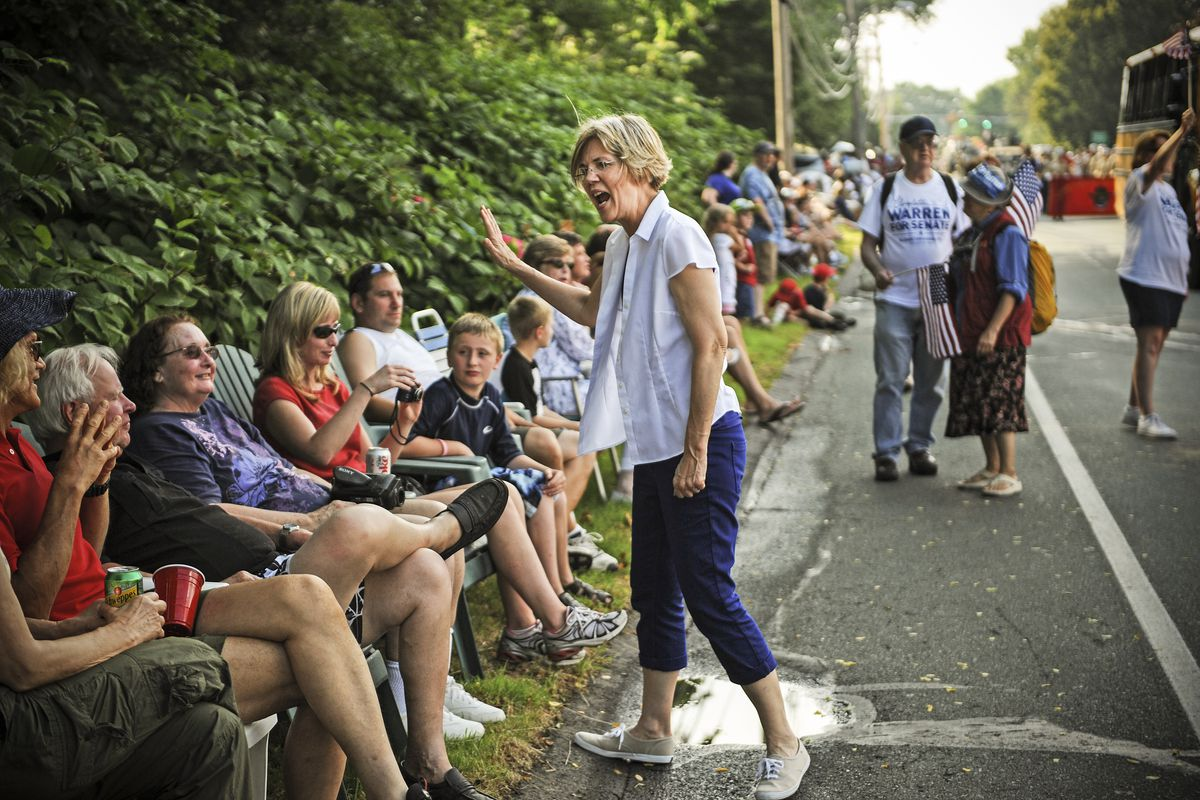 Then-Senate candidate Elizabeth Warren greets spectators during the Fourth of July parade in Wakefield, Massachusetts, in 2012.