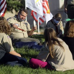 Scoutmaster Thomas Carlisle demonstrates how to bury your poop while camping during a Boy Scout meeting for the all-female Troop 314 at Parkview Park in Stansbury Park on Monday, July 6, 2020.