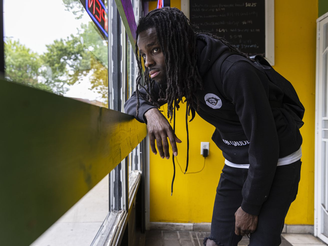 Social media influencer and rapper Korporate, a.k.a. Donovan Price, stops by Jerk 48, a Woodlawn restaurant often seen in his videos.