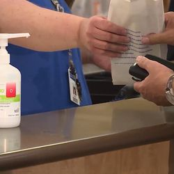 A customer picks up a prescription at Intermountain Healthcare's Salt Lake Clinic on Tuesday, Aug. 22, 2017. Intermountain Healthcare is working to reduce the number of opioid tablets its hospitals and clinics prescribe by 40 percent by the end of 2018.