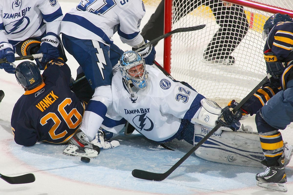 BUFFALO, NY - OCTOBER 25:Mathieu Garon #32 of the Tampa Bay Lightning makes a save against the Buffalo Sabres  at First Niagara Center on October 25, 2011 in Buffalo, New York.  (Photo by Rick Stewart/Getty Images)
