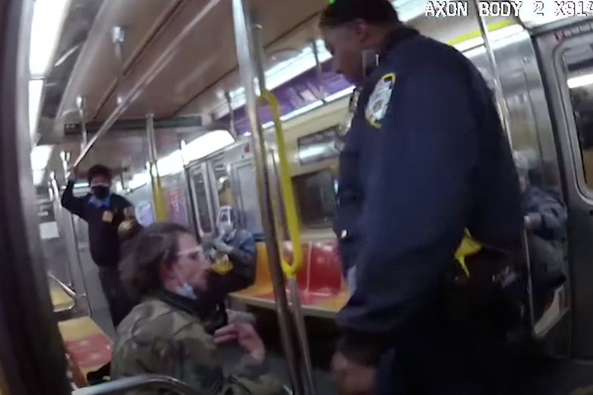 Joseph T., seated left, was injured after being hit and pepper sprayed by NYPD officers as they tried to remove him from a 6 train at 51st Street, May 25, 2020.