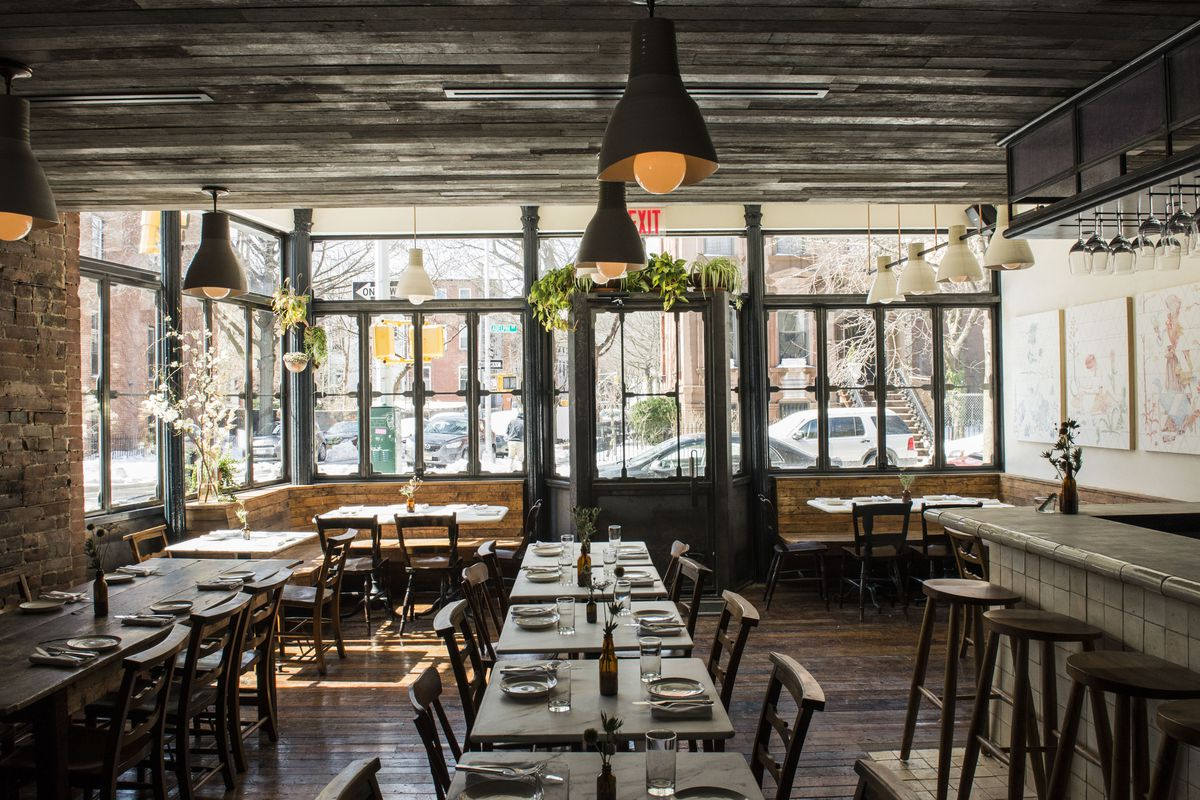 Metta's rustic interior, with dining tables set