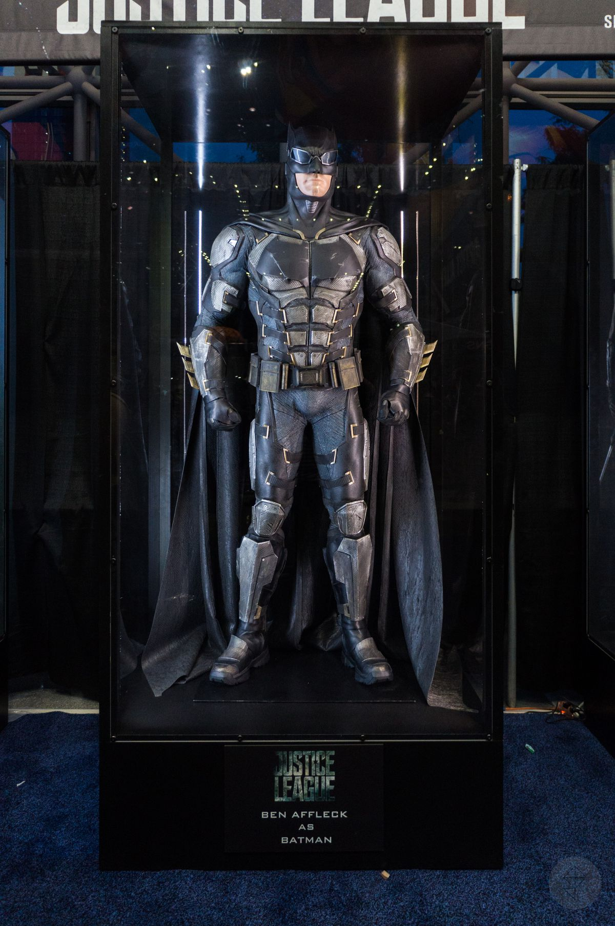 Batman costume from Justice League movie in glass case at NYCC 2017