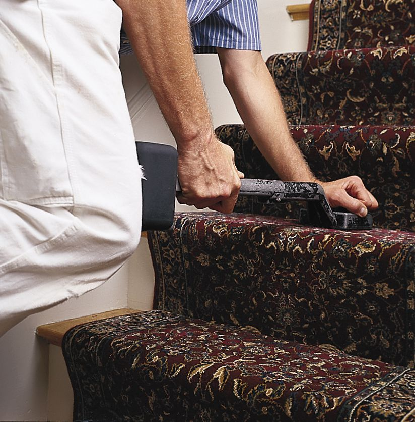 Man Attaches Stair Runner To Treads With Knee Kicker