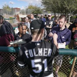 Chicago White Sox's Carson Fulmer signs autographs during a spring training baseball workout Saturday, Feb. 16, 2019, in Glendale, Ariz.   Morry Gash/Associated Press