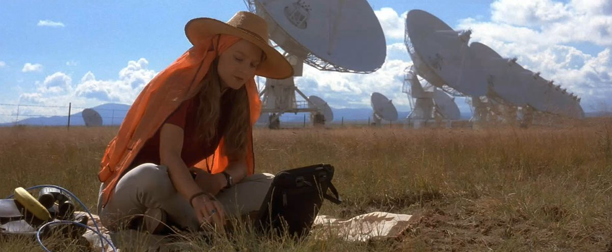 Jodie Foster sitting in front of satellite dishes in Contact