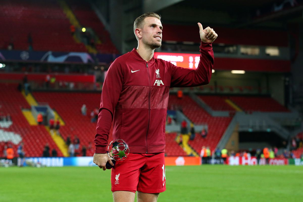 Jordan Henderson of Liverpool poses for a photo with the player of the match award following the UEFA Champions League group B match between Liverpool FC and AC Milan at Anfield on September 15, 2021 in Liverpool, England.