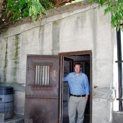 An innocent Adam Leishman of Lagoon?s marketing department stands at the doorway of the 125-year-old resort's actual concrete jail, which housed troublemakers during its early days behind barred doors and windows. Lagoon had a tavern in those days. Drunkenness and fighting were not uncommon.