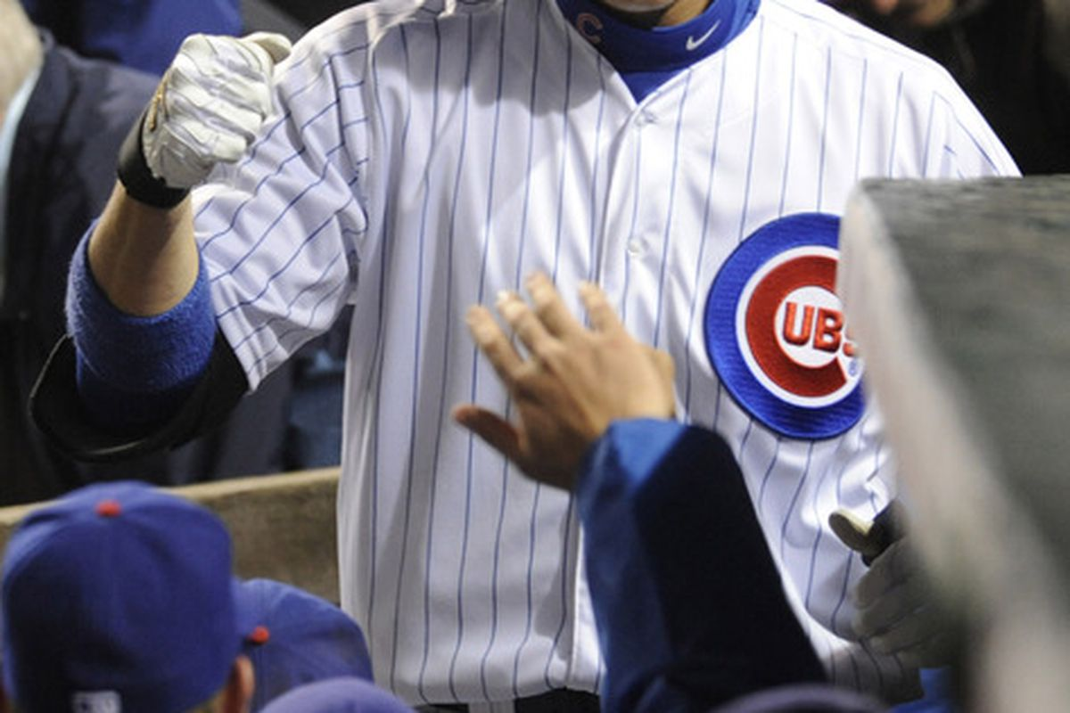 Bryan LaHair of the Chicago Cubs gets congratulated after hitting a solo home run against the Atlanta Braves at Wrigley Field in Chicago, Illinois.  (Photo by David Banks/Getty Images)
