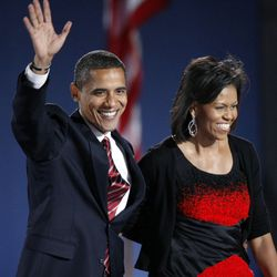 Barack Obama and his wife Michelle acknowledge the crowd after he delivered his victory speech in Grant Park. | AP photo