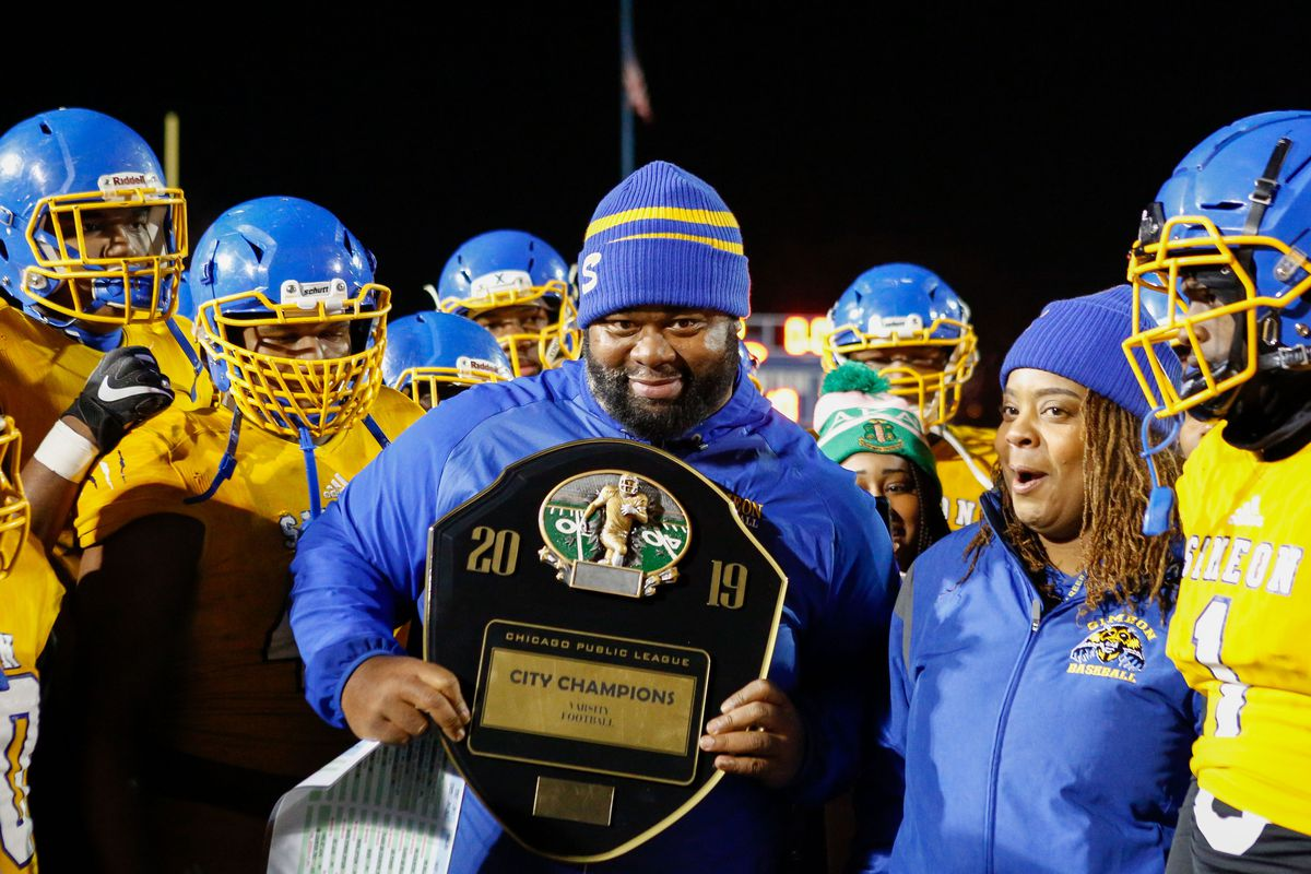 Simeon coach Dante Culbreath holds the 2019 City Champions plaque after winning the game against Morgan Park.