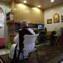 Archy Jacob sits in a sound room during a mass at St. Mary and St. Verena Orthodox Coptic Church in Anaheim, Calif., Wednesday, Sept. 19, 2012.
