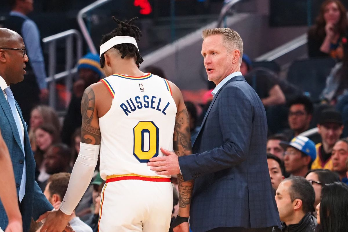 Golden State Warriors head coach Steve Kerr speaks to guard D'Angelo Russell as a timeout is called against the Minnesota Timberwolves during the second quarter at Chase Center.
