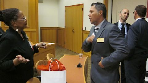 Sharon Brown Bailey, chair of the Colorado Black Round Table Education Committee, talks to Gregory Anderson, dean of the DU Morgridge College of Education, following a symposium Friday.