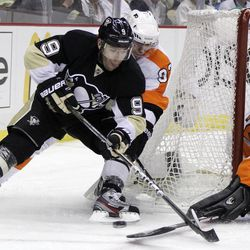 Pittsburgh Penguins' Pascal Dupuis (9) has the puck poked off his stick by  Philadelphia Flyers goalie IIya Bryzgalov (30) during the second period in Game 2 of an opening-round NHL hockey playoff series in Pittsburgh, Friday, April 13, 2012.