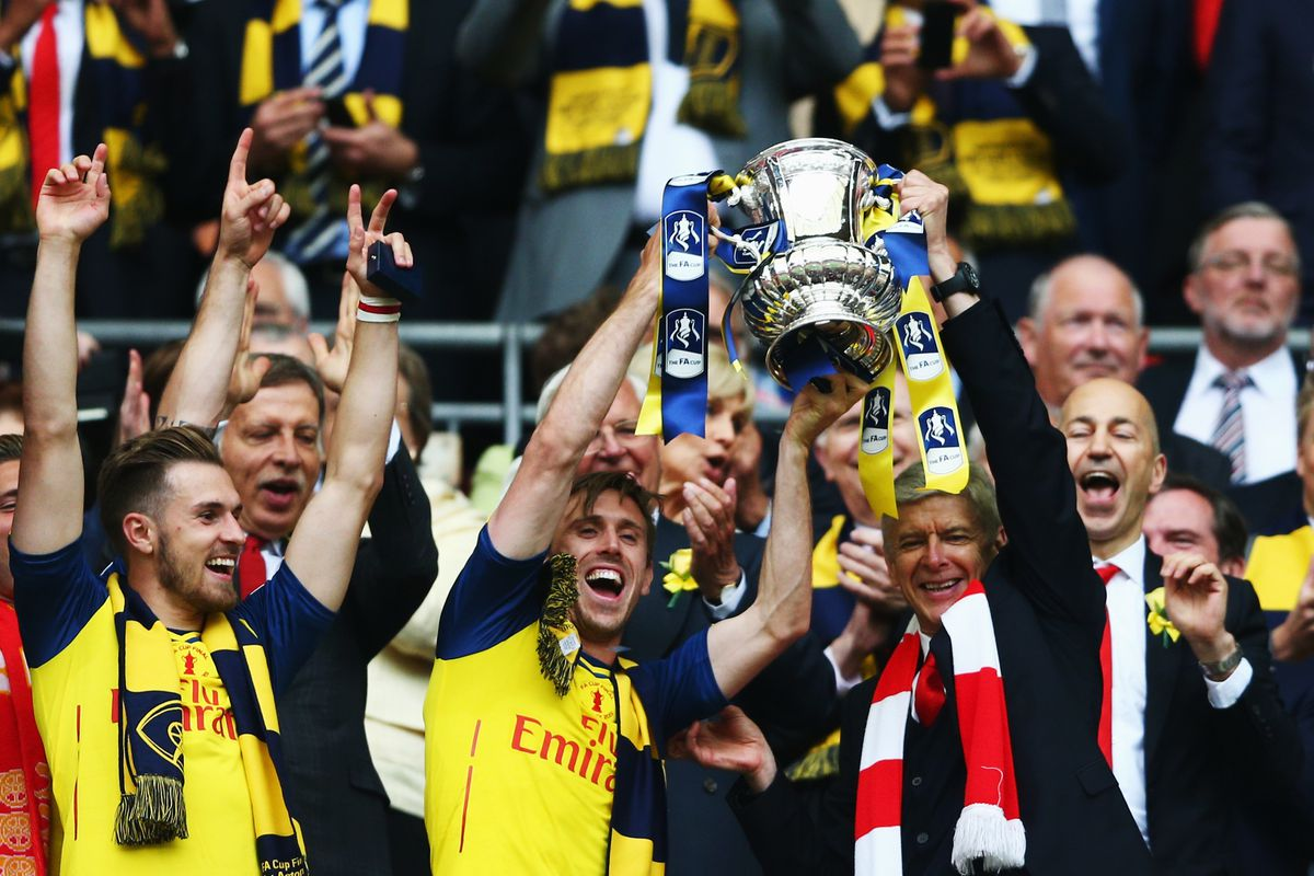 we will use every picture of any Arsenal player holding the Cup