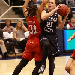 BYU's Lexi Eaton shoots over Utah's Ciera Dunbar during a women's basketball game at the Marriott Center in Provo on Saturday, Dec. 14, 2013. Utah won in double overtime 82-74.